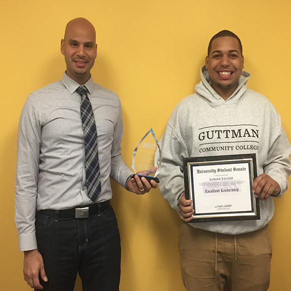 Manny Lopez (L) and Adrian Escoto receive awards from the University Student Senate.