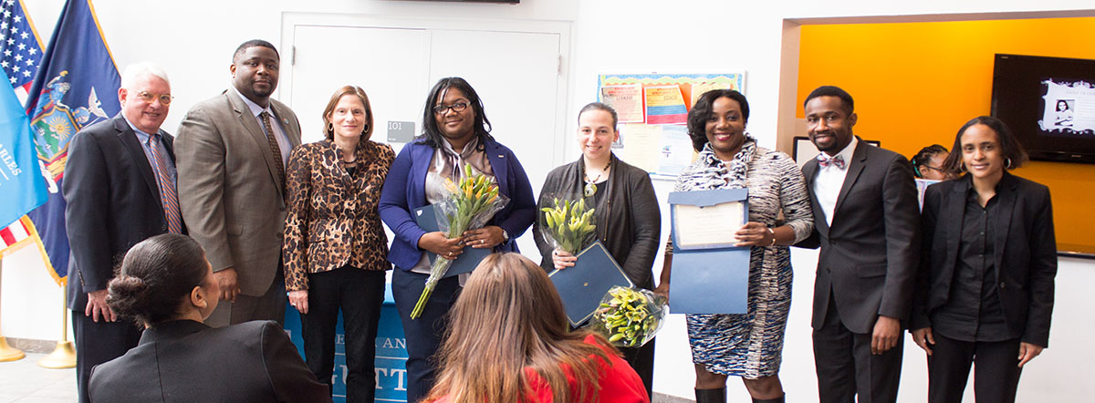 Guttman Student Food Pantry Ceremony: (L to R): Scott E. Evenbeck; Charles H. Pryor, II; Joan M. Lucariello; honorees Nicola Blake, Nicole Saint-Louis, and Carolee Ramsay; Kednel Jean; and Samantha Gregoire-James.