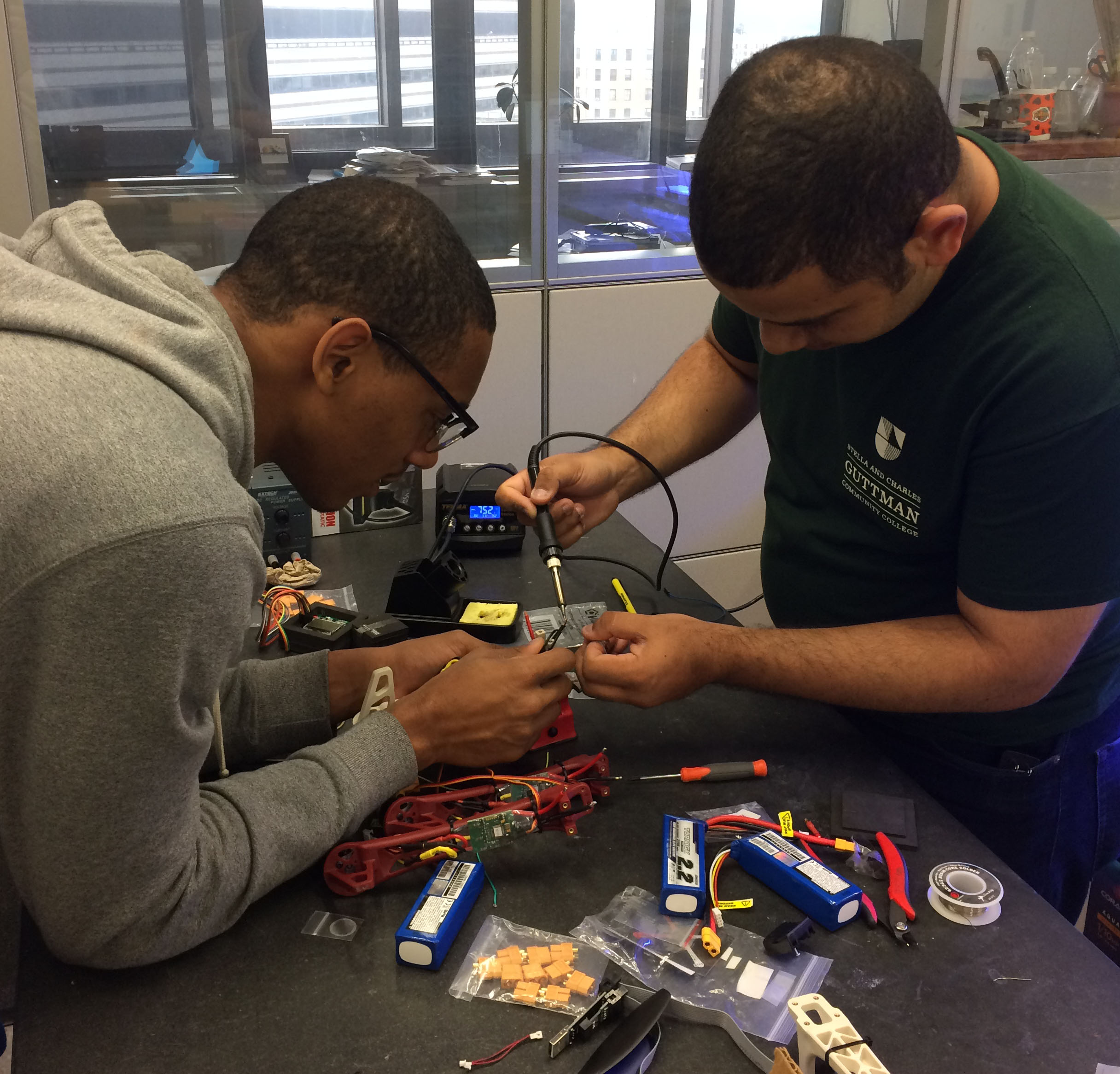 Miguel Hidalgo Almonte and Marcos Fermin Lopez working on the quadcopter at City College.