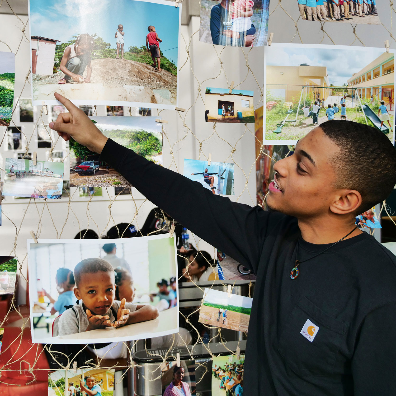 Harry Montas showing his photos in the Atrium