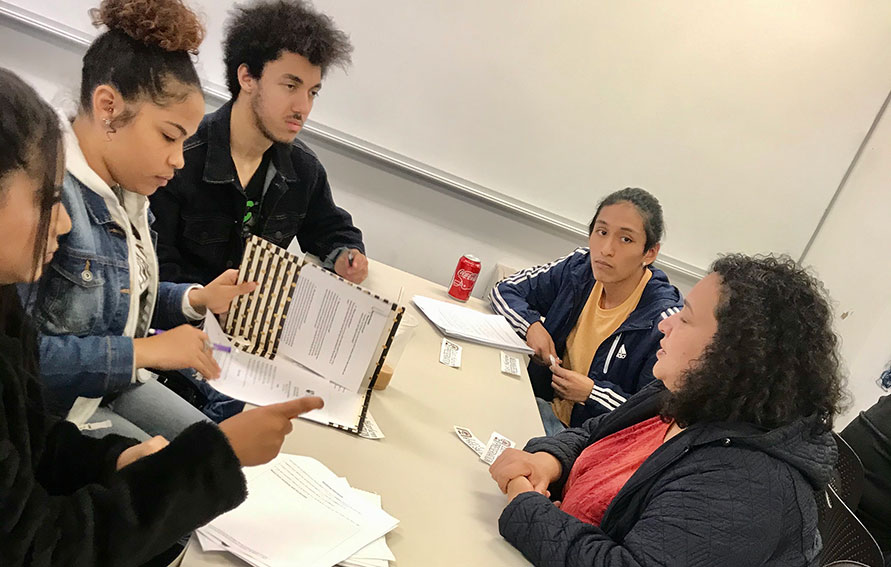 Students in a discussion at a table