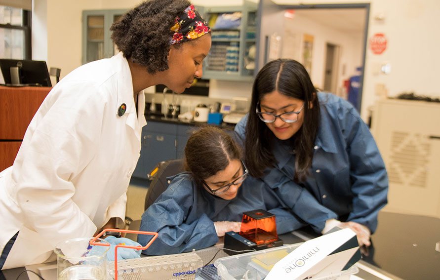 Dr. Karla Fuller with students in a science lab