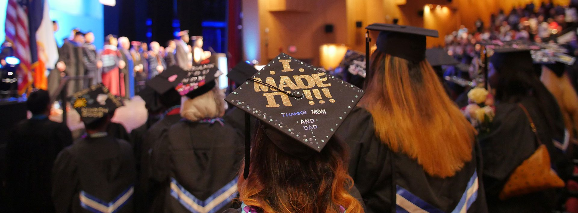 Commencement photo of a young woman's cap featuring the words