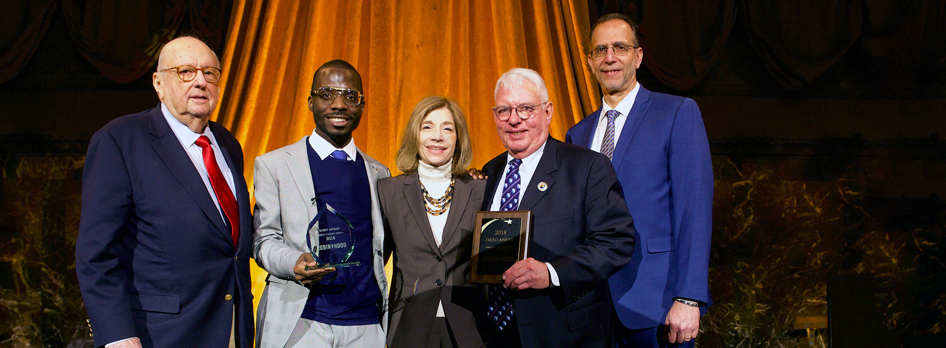 Robin Hood Foundation honors Guttman and alumnus Bobby Ashley with Hero Award