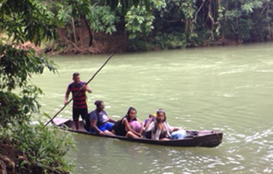 Students in a river boat in Belize