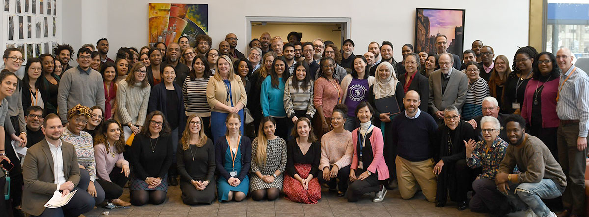 Group photo of faculty and staff at the All-College Meeting