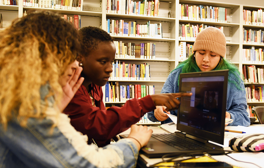 Students looking at a laptop screen