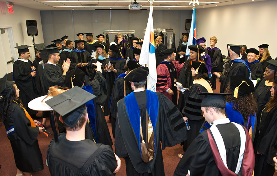Faculty and staff getting ready to march to the ceremony
