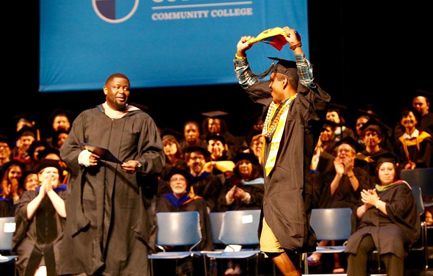 Graduate walking across the stage